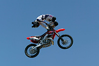 """Jul 01, 2003; Anaheim, California, USA; Moto X star athlete MYLES RICHMOND executing a backbend stunt over the handlebars catching some big air on a full sized motobike at the opening of Disney's California Adventure """"X Games Experience"""".  Disney park has built two X-Arena's specifically for this 41 day event highlighting extreme sports for the launch of the 2003 ESPN X Games.<br />Mandatory Credit: Photo by Shelly Castellano/Icon SMI<br />(©) Copyright 2003 by Shelly Castellano"""