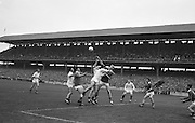 GAA All Ireland Minor Football Final Kerry v Mayo 23rd September 1962 Croke park...Kerry's P.O'Donohoe fists clear under pressure from Mayo forwards ..23.9.1962  23rd September 1962..All Ireland SFC - Final.Kerry 1-12 | Roscommon 1-6.Time: Unknown, Venue: Croke Park.Referee: E. Moules (Wicklow).Captain: S.g Sheehy..Attendance: 75,771