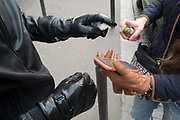 """March, 17th, 2020 - Paris, Ile-de-France, France: A French couple moving out of Paris to the countryside, take precautions with masks, gloves and alcohol sprays, to combat the spread of Coronavirus during the first day of near total lockdown imposed in France. The day before, President of France, Emmanuel Macron, said the citizens must stay at home from midday on Tuesday for at least 15 days. He said """"We are at war, a public health war, certainly but we are at war, against an invisible and elusive enemy"""". All journeys outside the home unless justified for essential professional or health reasons are outlawed. Anyone flouting the new regulations would be punished. Nigel Dickinson"""