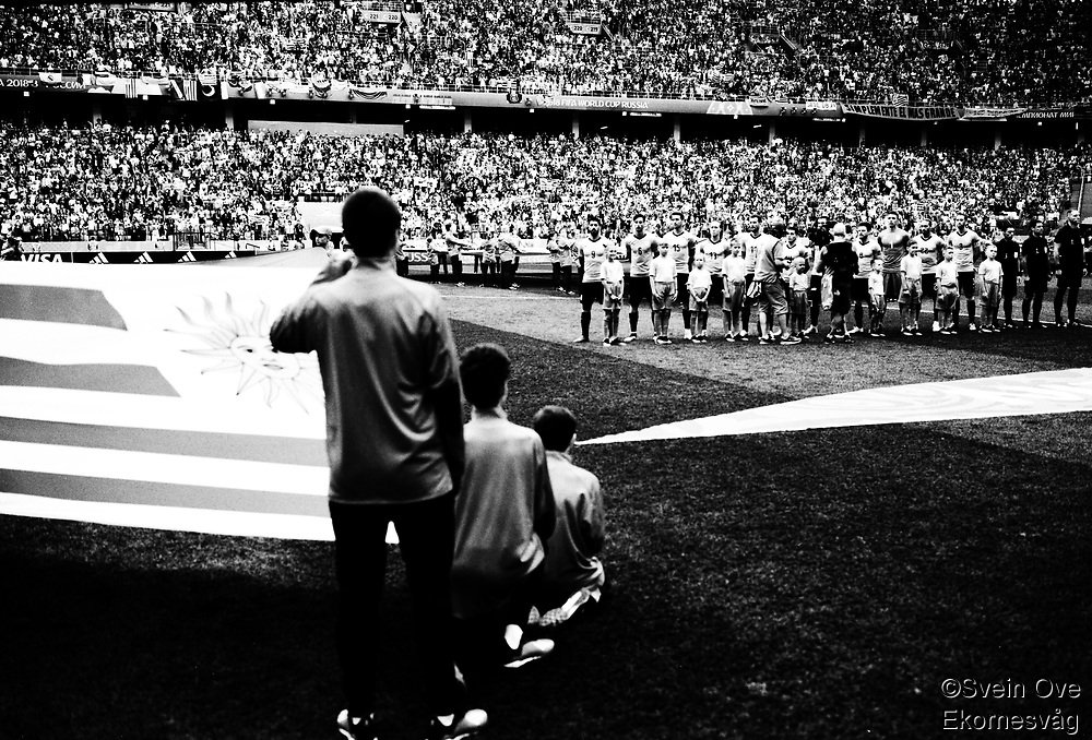 """""""The Beautiful Game"""" - <br /> Some of the most emotional moments during the FIFA World Cup 2018 was for sure the national anthems before kick-off. The atmosphere during some of the national anthems totally blew me away, especially for the South American teams and their supporters. The passion they have for the beautiful game really moved me. One of those magical moments happened here when Uruguay met France in the quarter finals match in Nizhny Novgorod.  This moment I captured on medium format film with my 6x9 rangefinder. Luis Suarez to the left.<br /> <br /> Foto: Svein Ove Ekornesvåg"""