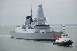 © Licensed to London News Pictures. 20/10/2016. Portsmouth, UK.  HMS Dragon returns to Portsmouth during a time when Royal Navy ships are actively involved with escorting Russian Naval ships  from the North Sea through the English Channel as they make their way to the Mediterranean.  Photo credit: Rob Arnold/LNP