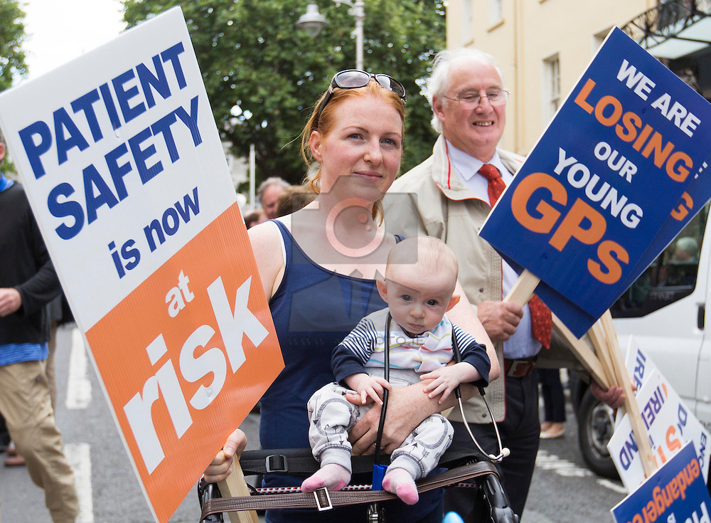 Repro Free: 24/09/2014 Dr Orna McLoughlin from City West is pictured with her 3 month old son Sebastian as for the first time in the history of the state, GPs have been motivated to protest as patient safety is now at risk. GPs (as part of NAGP/ National Association of General Practitioners) outside Leinster House. Picture Andres Poveda