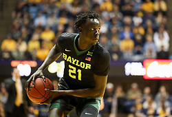Jan 9, 2018; Morgantown, WV, USA; Baylor Bears forward Nuni Omot (21) looks to pass during the first half against the West Virginia Mountaineers at WVU Coliseum. Mandatory Credit: Ben Queen-USA TODAY Sports