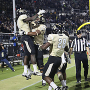 UCF Knights wide receiver Breshad Perriman (11) celebrates a 52 yard touchdown reception late in the fourth quarter of the NCAA football game between the South Florida Bulls and the 17th ranked University of Central Florida Knights at Bright House Networks Stadium on Friday, November 29, 2013 in Orlando, Florida. This Knights won the game 23-20. (AP Photo/Alex Menendez)