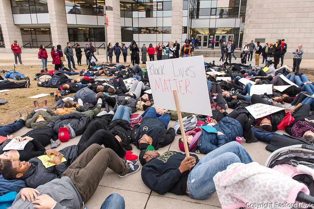 Iowa State University students march in silent protest against the recent deaths of black persons at the hands of police in Missouri, New York, and other locations.