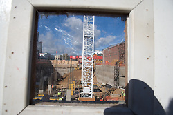 Looking through the window of a building safety barrier at the Huntingdon Street project; a busy construction site in Nottingham,