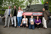 Injured war photographer Paul Conway with members of the campaign staff and bloggers. Campaigners and supporters from Oxfam and Amnesty International, as part of the Control Arms coalition, drive an Abbot gun tank around central London to highlight the need for a global Arms Trade Treaty (ATT) to be agreed during a United Nations conference next month (July 2012). London, England, UK. 27th June 2012.