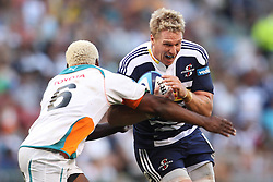 CAPE TOWN, SOUTH AFRICA - 5 MARCH 2011, Jean de Villiers (c) of the Stormers attempts to get past Kabamba Floors of the Cheetahs during the Super Rugby match between DHL Stormers and Cheetahs at DHL Newlands Stadium in Cape Town, South Africa..Photo by Shaun Roy / Sportzpics