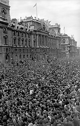 """Embargoed to 2100 Friday May 08 File photo dated 08/05/45 showing huge crowds at Whitehall, celebrating VE (Victory in Europe) Day in London. As the Queen spoke of the jubilant celebrations which """"some of us experienced first-hand"""", she was no doubt thinking back to her own VE Day adventures."""