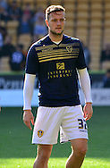 Liam Cooper warms up during the Sky Bet Championship match between Wolverhampton Wanderers and Leeds United at Molineux, Wolverhampton, England on 6 April 2015. Photo by Alan Franklin.
