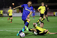 AFC Wimbledon defender Barry Fuller (2) riding a challange during the Pre-Season Friendly match between AFC Wimbledon and Burton Albion at the Cherry Red Records Stadium, Kingston, England on 21 July 2017. Photo by Matthew Redman.