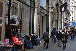 © Licensed to London News Pictures.  14/03/2012. LONDON, UK. Fans queue outside the flagship Apple store in Regent Street London ahead of the Friday (16 March)  launch of the new iPad 3. First in the queue Zohaib Ali (pictured seated right), 21, a pharmacy worker from Uxbridge, started queuing at 1pm on Saturday, six days before the product goes on sale. In this photo seated right to left, Zonhaib Ali (21). Vik Rathor (25), Mike Roberts (22), Craig Fox (30).  Photo credit :  Cliff Hide/LNP