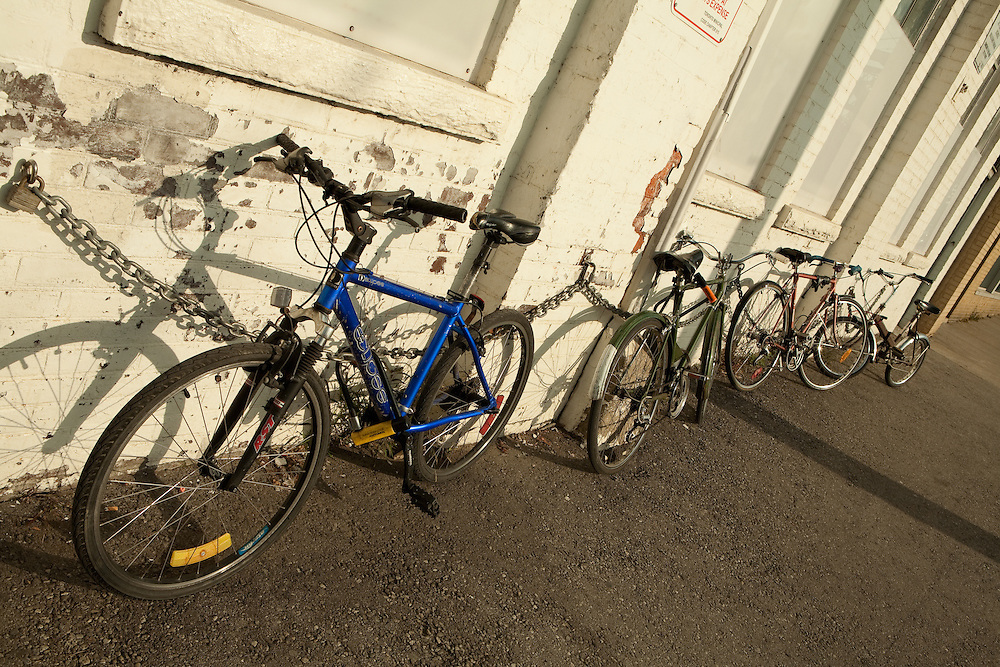 A row of bicycles, a popular means of transportation in Toronto, chained to a wall on Bathurst Street.