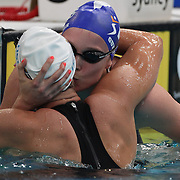 Lisbeth Trickett is congratulated by Marieke Guehrer after winning the women's 100m freestyle during the Australian Swimming Championships and Selection Trials for the XIII Fina World Championships held at Sydney Olympic Park Aquatic Centre, Sydney, Australia on March 19, 2009. Photo Tim Clayton