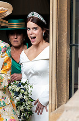 Princess Eugenie leaving Windsor Castle after her wedding for an evening reception at Royal Lodge.