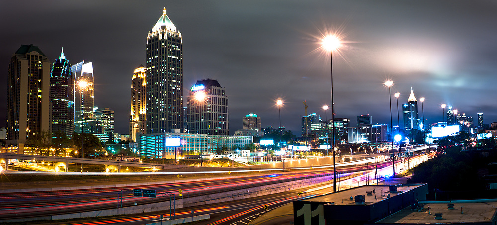 The Atlanta skyline and Interstate 85 are seen in a long exposure at night
