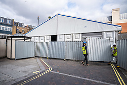 © Licensed to London News Pictures. 18/03/2020. London, UK. Workmen construct a makeshift mortuary which has been put up behind Westminster Coroners Court in Horseferry Road as the Coronavirus pandemic crisis continues. Photo credit: Alex Lentati/LNP