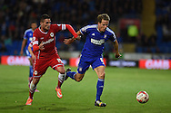 Christophe Berra of Ipswich ® breaks away from Cardiff's Federico Macheda. Skybet football league championship match, Cardiff city v Ipswich Town at the Cardiff city stadium in Cardiff, South Wales on Tuesday 21st October 2014<br /> pic by Andrew Orchard, Andrew Orchard sports photography.