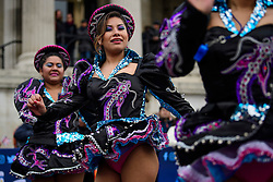 © Licensed to London News Pictures. 30/12/2016. London, UK. Bolivian dance group Caporales San Simon Londres take part in a warmup event for New Years celebrations, at Trafalgar Square in London. Security will be increased across most UK New Year celebrations this year following the Berlin Christmas market terrorism attack.  Photo credit: Ben Cawthra/LNP
