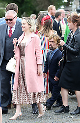 Actors Emilia Clarke, followed by Peter Dinklage leave Rayne Church, Kirkton of Rayne in Aberdeenshire, after the wedding ceremony of Game Of Thrones stars Kit Harington and Rose Leslie.