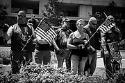 """06102017 - Indianapolis, Indiana, USA: Bikers from an anti """"radical Islam"""" group protest against Antifa, and other counter protesters. One biker tells counter protesters to come over so they can get, """"an ass kicking."""""""