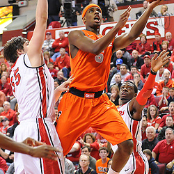 Syracuse Orange forward C.J. Fair (5) scores a layup past Rutgers Scarlet Knights forward Gilvydas Biruta (55) during first half NCAA Big East basketball action between #2 Syracuse and Rutgers at the Louis Brown Athletic Center. Syracuse leads 40-34 at halftime.