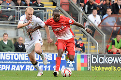 Milton Keynes Dons' Luke Chadwick and Leyton Orient's Moses Odubajo compete for the ball - Photo mandatory by-line: Mitchell Gunn/JMP - Tel: Mobile: 07966 386802 12/10/2013 - SPORT - FOOTBALL - Brisbane Road - Leyton - Leyton Orient V MK Dons - League One