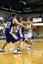 30 December 2006: Jordan Morris is stopped by a pair of defenders. The Titans outscored the Britons by a score of 94-80. The Britons of Albion College visited the Illinois Wesleyan Titans at the Shirk Center in Bloomington Illinois.<br />