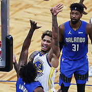 ORLANDO, FL - FEBRUARY 19:  Kelly Oubre Jr. #12 of the Golden State Warriors shoots the ball over Al-Farouq Aminu #2 of the Orlando Magic during the first half at Amway Center on February 19, 2021 in Orlando, Florida. NOTE TO USER: User expressly acknowledges and agrees that, by downloading and or using this photograph, User is consenting to the terms and conditions of the Getty Images License Agreement. (Photo by Alex Menendez/Getty Images)*** Local Caption *** Kelly Oubre Jr.; Al-Farouq Aminu
