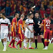 Referee's Huseyin Gocek show the yellow card to Galatasaray's Yasin Oztekin during their Turkish Super League derby match Galatasaray between Besiktas at the AliSamiYen Spor Kompleksi TT Arena at Seyrantepe in Istanbul Turkey on Sunday, 24 May 2015. Photo by Aykut AKICI/TURKPIX