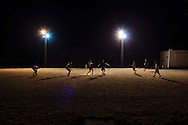 Men play a late-night game of football in Bizerte, Tunisia. Bizerte is the northernmost city in Africa.