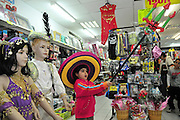 Israel, Purim A young Girl of 5 trying on Purim costumes in a toy store Model Release Available