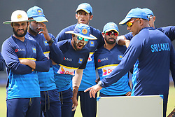 July 6, 2018 - Sri Lanka - Sri Lanka Cricket Batting Coach Thilan Samaraweera (R1) talks with team members during a practice session at the R. Premadasa Stadium in Colombo on July 6th of 2018. Sri Lanka and South Africa will play two Tests, five 50-over One-Day Internationals (ODIs), and one T20 in Sri Lanka between July 12 and August 14. The first Test between South African and Sri Lanka will be played on July 12 at the Galle International Cricket Stadium in Galle. (Credit Image: © Lahiru Harshana/Pacific Press via ZUMA Wire)