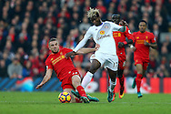 Jordan Henderson of Liverpool tackles Didier Ndong of Sunderland. Premier League match, Liverpool v Sunderland at the Anfield stadium in Liverpool, Merseyside on Saturday 26th November 2016.<br /> pic by Chris Stading, Andrew Orchard sports photography.