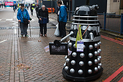 London, UK. 14th September, 2021. A Stop The Arms Fair activist operating a Dalek takes part in Stop The Arms Fair protests outside ExCeL London on the first day of the DSEI 2021 arms fair. Activists from a range of different groups have been protesting outside the venue for one of the world's largest arms fairs for over a week.