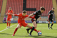 Leyton Orient's Dan Kemp (15) battles for possession with Lewis Spence (20) of Scunthorpe United during the EFL Sky Bet League 2 match between Leyton Orient and Scunthorpe United at the Breyer Group Stadium, London, England on 13 March 2021.