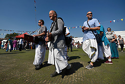 © Licensed to London News Pictures. 02/09/2018. WATFORD, UK.  Hare Krishna musicians entertain crowds as thousands of devotees attend the biggest Janmashtami festival outside of India at the Bhaktivedanta Manor Hare Krishna Temple in Watford, Hertfordshire.  The event, which celebrates the birth of Lord Krishna, includes a cultural and spiritual festival at a property donated to the Hare Krishna movement by ex Beatle George Harrison.  Photo credit: Stephen Chung/LNP