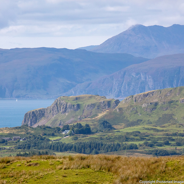 Dun Mor on Seil Island with the peaks of Mull behind, Argyll, Scotland.