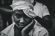 Every January 21st, in one of the oldest traditions that is celebrated in La Hispaniola island in the Caribbean, people from all corners -including many from Haiti- tavel as pilgrims to la Basilica de Nuestra Señora de La Virgen de La Altagracia in the city of Higuey, to honor and worship La Virgen. This religious figure is venerated by the Catholics, la Santería and the Vodou and is the most important religious cult in the island. Pilgrims sleep for days near the Basilica cathedral where the original image of La Virgen resides, and make promises and offerings in chants and prayers for them and their children and families. Editorial and Commercial Photographer based in Valencia, Spain |Portraits, Hospitality, News, Sports, Media Coverage for Events