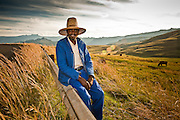 There are few things as dreamy as the ampitheatre in the nothern Drakensberg on a beautiful afternoon. This friendly cattle herder seemed content to enjoy the view, watch his cattle and sit for a portrait.