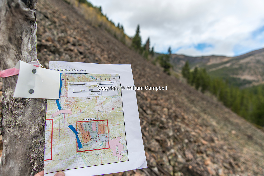 A Lucky Minerals claim marker and claims map in the DUV Allison area of Emigrant Gulch in Paradise Valley, Montana.