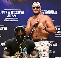 """(R)Tyson """"The Gypsy King"""" Fury taunts Deontay Wilder at the start of a Los Angeles press conference on their up coming 3rd fight Tuesday, Los Angeles CA.USA. June 15,2021<br /> The two will fight on Saturday, July 24, headlining a pay-per-view event live from T-Mobile Arena in Las Vegas NV (Photo by Gene Blevins)"""