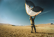 Matthieu Paley lifting off his tent to clean it. <br /> Mongolia is a trekker's paradise, with virtually unlimited possibilities of remote treks. Camping is available anywhere as land-ownership is impossible in Mongolia.