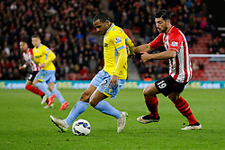 Jason Puncheon of Crystal Palace is challenged by Graziano Pelle of Southampton - Photo mandatory by-line: Rogan Thomson/JMP - 07966 386802 - 03/03/2015 - SPORT - FOOTBALL - Southampton, England - St Mary's Stadium - Southampton v Crystal Palace - Barclays Premier League.