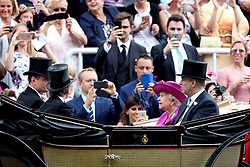 Queen Elizabeth II and the Duke of York arrive in a carriage for day five of Royal Ascot at Ascot Racecourse.