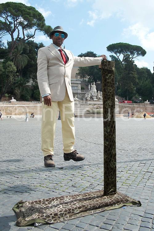 Street entertainer in Piazza del Polpolo, Rome, Italy.