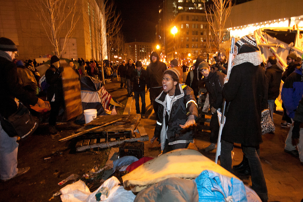 Boston, MA 12/08/2011.An Occupy Boston member shouts at others to leave his belongings alone as an effort to clear the camp of trash is underway in Dewey Square on Thursday night..Alex Jones / www.alexjonesphoto.com