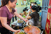 05 APRIL 2012 - HANOI, VIETNAM:   Women work in a noodle shop and restaurant in a market in Hanoi, the capital of Vietnam.   PHOTO BY JACK KURTZ