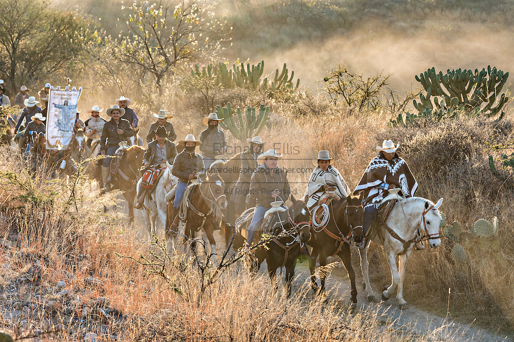 Hundreds of Mexican cowboys begin a day long ride at sunrise during the annual Cabalgata de Cristo Rey pilgrimage January 5, 2017 in San José del Rodeo, Guanajuato, Mexico. Thousands of Mexican cowboys and horse take part in the three-day ride to the mountaintop shrine of Cristo Rey stopping along the way at shrines and churches.