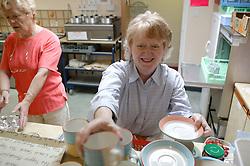 Age concern carers week; volunteers preparing refreshments in the kitchen,